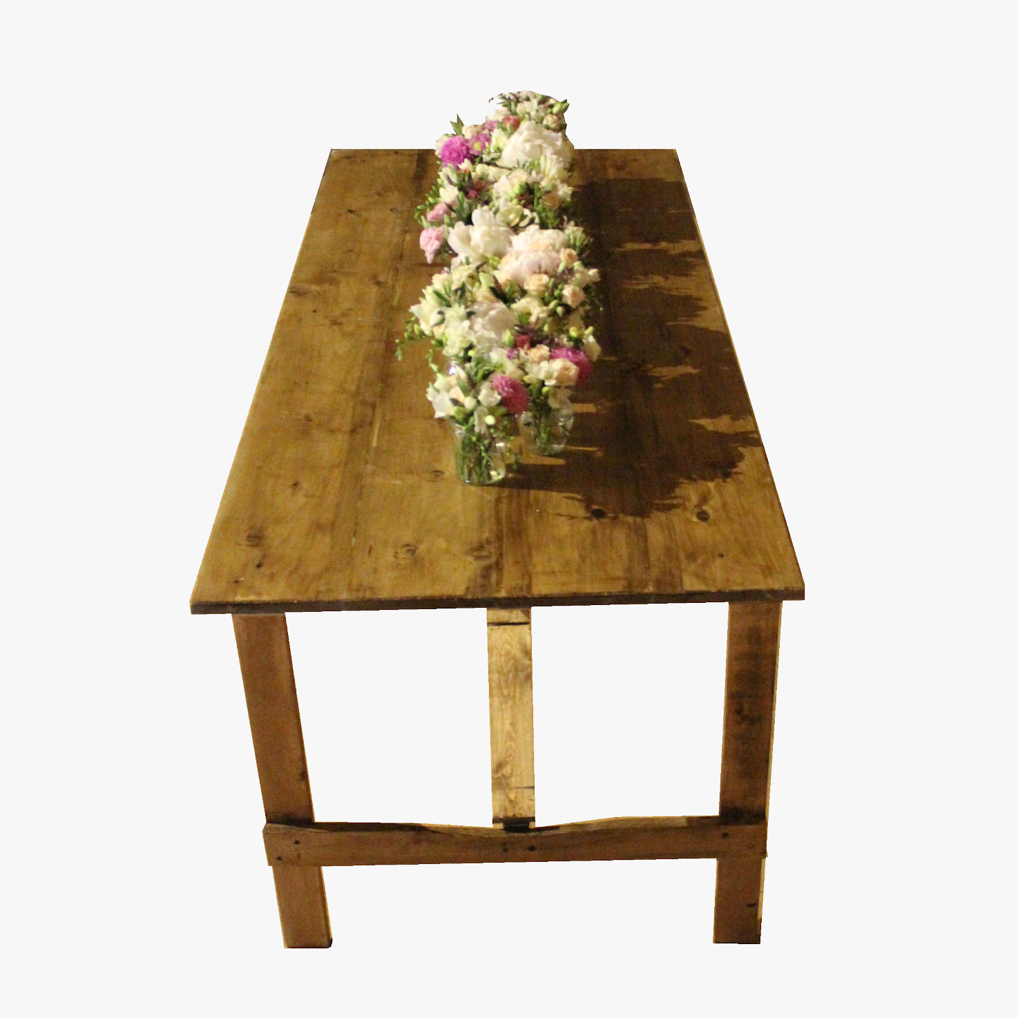 Rustic table with flowers for event hire